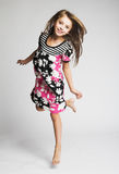 Little girl jumping of joy. Little blond girl jumping of joy Royalty Free Stock Photography