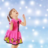 Little girl jumping and looking up Stock Image