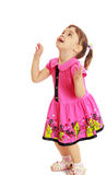 Little girl jumping and looking up Royalty Free Stock Photo