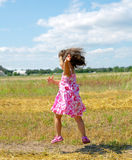 Little girl jumping on the meadow Royalty Free Stock Images
