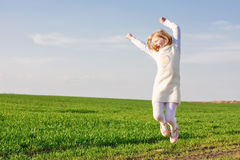 Little girl jumping outdoor Stock Photo