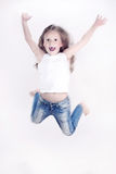 Little girl jumping over the white background. Little girl jumps on a white background Stock Photos