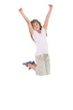 Little girl jumping and putting her hands up Stock Photography