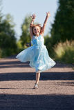 Little girl jumping and rejoicing Royalty Free Stock Photography
