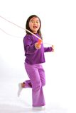 Little Girl Jumping with Rope Stock Images