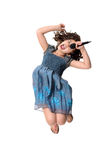 Little girl jumping and singing Stock Photography