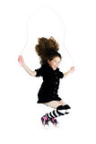 Little girl jumping skipping rope. Caucasian little girl jumping skipping rope isolated studio on white background Royalty Free Stock Images