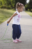 Little girl jumping skipping rope Royalty Free Stock Images