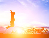 little girl jumping to sky and having happy time, Silhouette con Royalty Free Stock Image