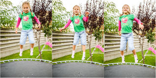 Little girl jumping on trampoline Royalty Free Stock Images