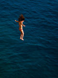 Little girl jumping in the water Royalty Free Stock Images