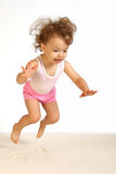 A little girl jumps. Royalty Free Stock Images