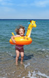 Little girl jumps in the sea Stock Photography