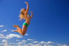 Little girl jumps in the sky Royalty Free Stock Photos