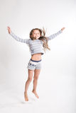 Little girl jumps on a white background Royalty Free Stock Photo