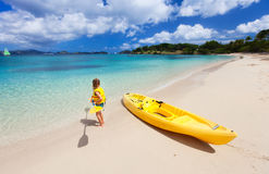 Little girl with kayak Royalty Free Stock Images