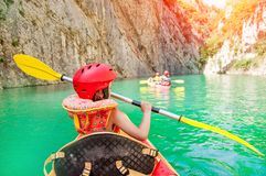 Little girl kayaking on beautiful river, having fun and enjoying sports outdoors. Water sport and camping fun. Mont-rebei gorge stock photos