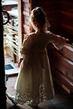 Little girl keep door open Royalty Free Stock Images