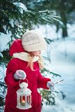 Little girl with a flashlight and Bengal lights. Forest, winter Royalty Free Stock Images