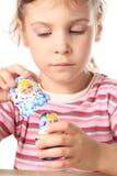 Little girl keep matryoshka isolated Royalty Free Stock Photos