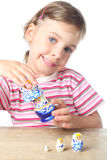 Little girl keep matryoshka and smiling isolated Royalty Free Stock Images