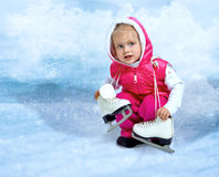 Little girl keep skates Stock Photography