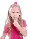 Little girl keeping quiet Stock Photo