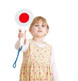 Little girl keeping stopping sign Royalty Free Stock Photography
