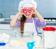 Little girl and keeps cookie cutters Stock Photo