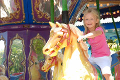 Little girl at kermis Stock Photos