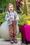 Little girl kid blow dandelion. On park Stock Photography