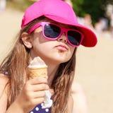 Little girl kid eating ice cream on beach. Summer. Stock Photo