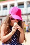 Little girl kid eating ice cream on beach. Summer. Royalty Free Stock Photo