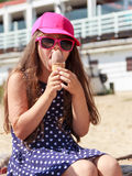 Little girl kid eating ice cream on beach. Summer. Stock Photos