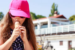 Little girl kid eating ice cream on beach. Summer. Stock Photo