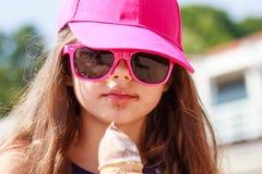 Little girl kid eating ice cream on beach. Summer. Royalty Free Stock Photography