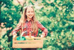 Little girl kid in forest. little girl with gardening tools. earth day. spring village country. ecology environment