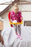 Little girl kid having fun on a swing. outdoors Royalty Free Stock Image