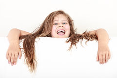 Little girl kid with long hair holds empty banner. Stock Image