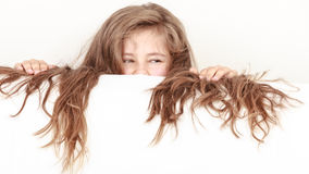 Little girl kid with long hair holds empty banner. Stock Photos