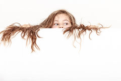 Little girl kid with long hair holds empty banner. Royalty Free Stock Photos