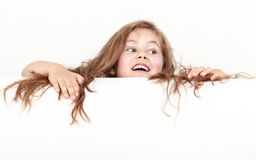 Little girl kid with long hair holds empty banner. Royalty Free Stock Photography