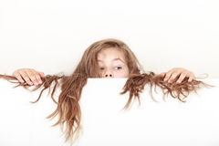 Little girl kid with long hair holds empty banner. Royalty Free Stock Image