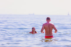 Little girl kid and man father in sea water. Fun Stock Photo