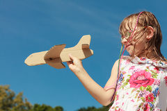 Little girl kid outdoor with paper plane airplane. Stock Photography