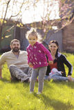 Little girl kid playing, having fun with mother and father. Stock Photo