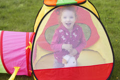 Little girl kid playing, having fun. outdoors Royalty Free Stock Images