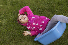 Little girl kid playing, having fun. outdoors Stock Images