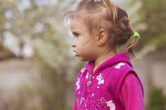 Little girl kid playing, having fun. outdoors Royalty Free Stock Photo