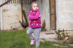 Little girl kid playing, having fun. outdoors Royalty Free Stock Photos